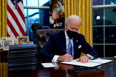 President Joe Biden signs an Executive Order on rejoining the Paris Climate Accord.