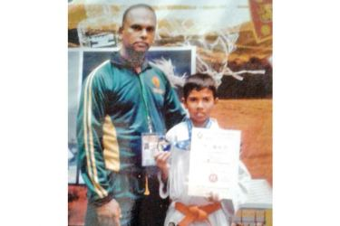 Ishan Chamika Appuhamy is seen here after receiving the Black Belt with his coach at the ISKU Shotokan Kumite Grading Ceremony in 2020. (Picture by Dilwin Mendis Moratuwa Sports Special Correspondent)