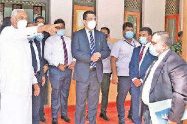 Justice Minister Ali Sabry, PC who went on an inspection tour of the Tissamaharamaya, Hambantota and Tangalle Courts Complexes discuss a point with National Security, Home Affairs and Disaster Management State Minister of Chamal Rajapaksa and officials.
