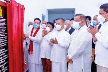 Prime Minister  Mahinda Rajapaksa, Minister of Power, Dullas Alahapperuma and Chairman of Aitken Spence D.H.S. Jayawardena open the Waste-to Energy plant.