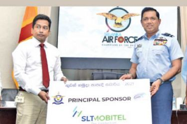 Nalin D. Gamage (Head of Project Management Office, SLT-Mobitel) handing over the sponsorship cheque to Commander of Sri Lanka Air Force, Air Marshal Sudarshana Pathirana.    Pic by Samantha Weerasiri