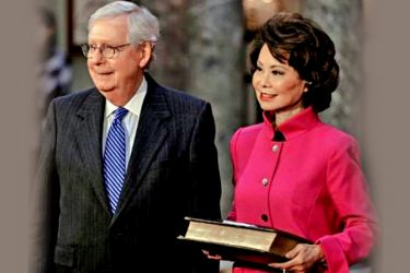 Senate Republican leader Mitch McConnell (L) and his Chinese-American wife Elaine Chao  who was Transportation Secretary in Donald Trump's Cabinet.
