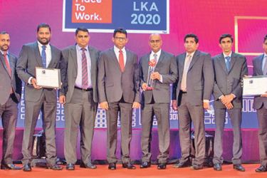 HNB Finance Managing Director and Chief Executive Officer Chaminda Prabhath with staff receive the Best Place to Work accreditation.