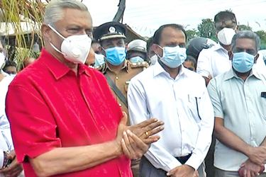 Filephoto:Minister Chamal Rajapaksa and officials assuring farmers at the site earlier.