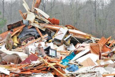 The damage caused by storms that swept the southern US and Midwest last year.