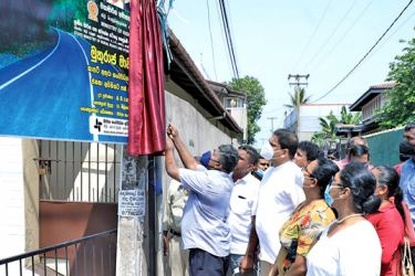 State Minister Nimal Lanza opening the Magul Pokuna Church Road in Wattala yesterday.