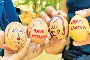 Easter eggs are painted with slogans from the protests against the military coup, in Mandalay, Myanmar on Sunday.