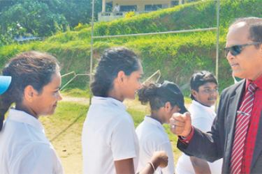 The girls cricket team of Nugawela National School being introduced to the Chief Guest, Dampiya Wanasinghe, the Principal of Dharmaraja College,Kandy by the Captain of Nugawela National School Sansala Wanigasekera.    ( Picture by Upananda Jayasundera-Kandy Sports spl.Corr