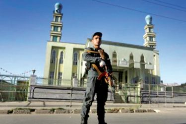An Afghan Policeman stands guard outside a mosque where a shooting took place in the city of Jalalabad.