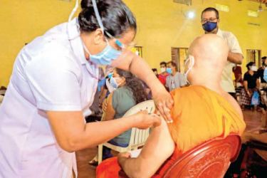 A Venerable Thera being vaccinated in Wattala.