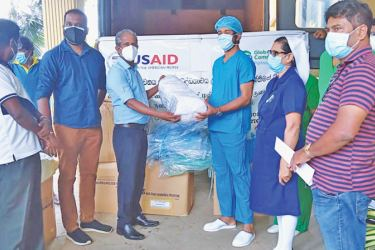 HDCC, SCORE and Hambantota COVID 19 hospital officials at the donation