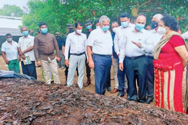 State Minister Siripala Gamalath along with officials inspecting a organic fertilizer manufacturing site. Picture by  Kelum Liyanage.