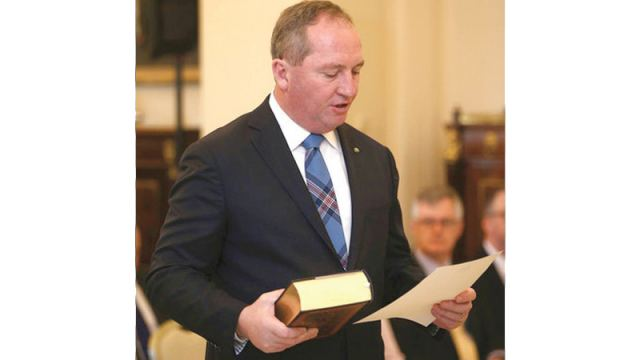 In this July 19, 2016, file photo Australia's Deputy Prime Minister Barnaby Joyce takes the oath of office as he is sworn in at Government House in Canberra, Australia.- AFP