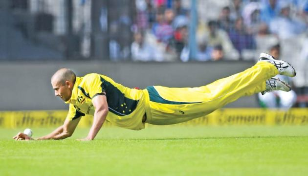 This file photo taken on September 21, 2017 shows Australia's Ashton Agar diving to stop the ball during the second one day international (ODI) match in the ongoing India-Australia cricket series at the Eden Gardens Cricket Stadium in Kolkata. AFP