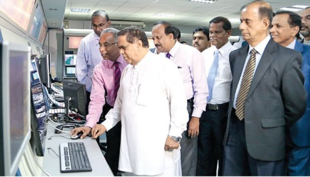 The Automatic Dependence Surveillance Broadcast (ADS-B) Operations at  the Area Control Centre at the Colombo Airport in Ratmalana was  inaugurated by Transport and Civil Aviation Minister Nimal Siripala De Silva while officials look on.