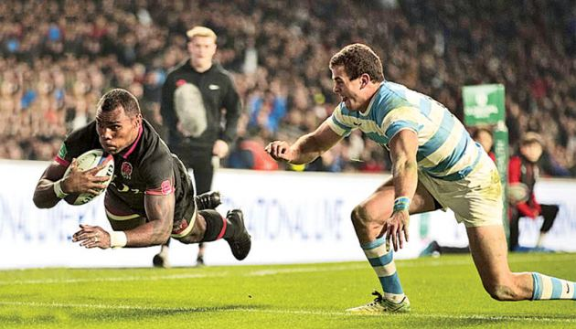 England's wing Semesa Rokoduguni dives over the Argentina try line to score their second try of the match in the second half.