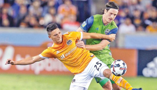 Tomas Martinez #25 of Houston Dynamo attempts to control the ball as Gustav Svensson #4 of Seattle Sounders defends at BBVA Compass Stadium on November 21 in Houston, Texas. AFP