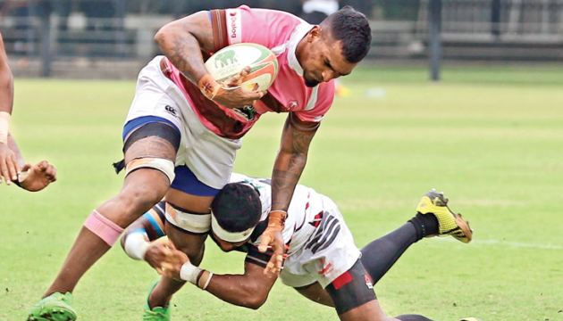 Havelock Sports Club flanker Sharo Fernando is well tackled by a CH and FC defender in their Dialog A Division League rugby match played at Race Course ground yesterday Picture by Malan Karunaratne