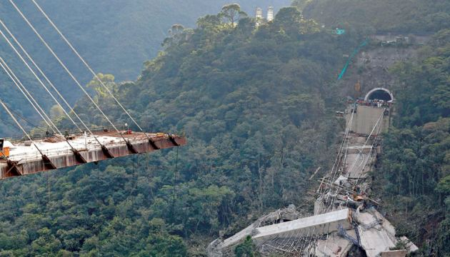 View of a bridge under construction that collapsed leaving several dead and injured workers in Chirajara, Colombia.