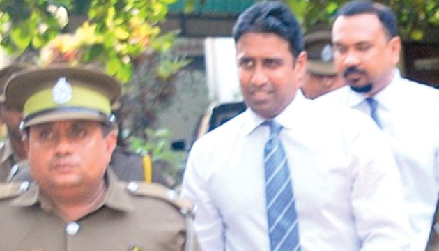 Perpetual Treasuries Limited (PTL) beneficiary owner Arjun  Aloysius and its Chief Executive Officer Kasun Palisena leaving the Colombo Fort  Magistrate's Court. Picture by Lionel P. Perera