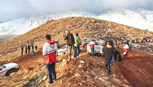 Rescue workers searching for the wreckage of an Iran Aseman Airlines plane in the Zagros mountain range on Monday. - AFP