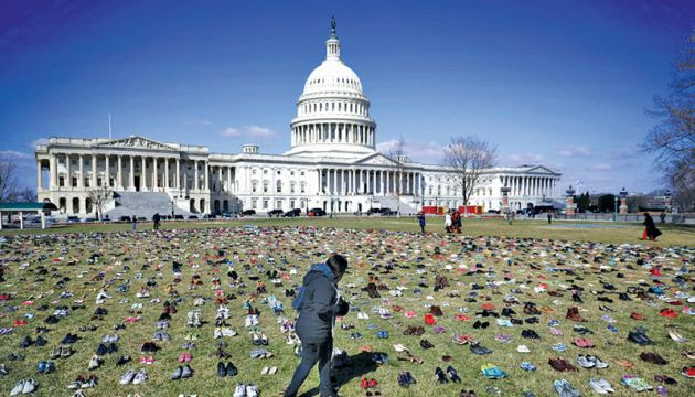 The pairs of shoes indicate the number of children killed by US gun violence in the last five years.