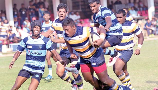 Peterite prop forward Julian Charles (ball in hand) is barging over to score his try.  Picture by Saman Sri Wedage