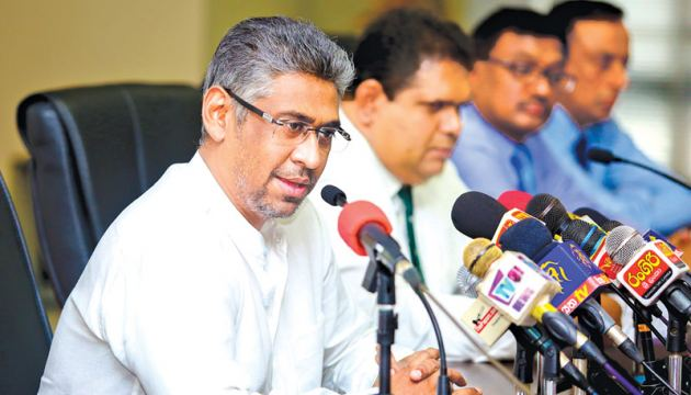 Sports Minister Faiszer Musthapha addressing a meeting of rugby officials at the Sports Ministry yesterday flanked by Deputy President of Sri Lanka Rugby Lasitha Gunaratne.