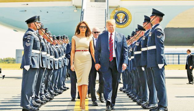 President Donald Trump and First Lady Melania Trump are greeted by an honour guard of Royal Air Force personnel after disembarking Air Force One at Stansted Airport on Thursday.