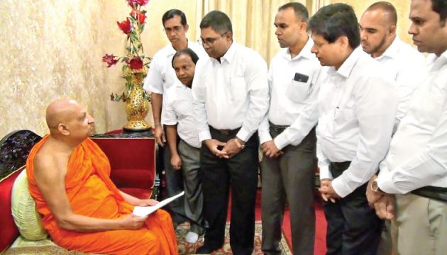 Delegates of the two matchstick producers' associations met the Malwatte Mahanayake Thera Most Venerable Thibottuwawe Sri Sumangala Thera to present their problems yesterday. Picture by Asela Kuruluwansa