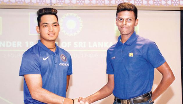 Indian U19 captain Anuj Rawat shakes hands with Sri Lanka U19 captain Nipun Dananjaya at the media conference held at Hilton Colombo Residencies yesterday. Picture by Shan Rambukwella