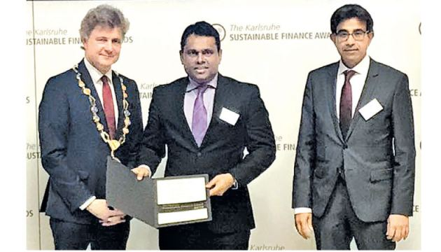 Bathiya Alahakoon, Senior Vice President (Branch Banking), DFCC Bank, accepting the award on behalf of DFCC Bank. The presentations were made at the Karlsruhe City Hall on July 12, 2018 by Dr. Frank Mentrup (Lord Mayor of Karlsruhe) and Arshad Rab (CEO of the European Organization for Sustainable Development – EOSD).