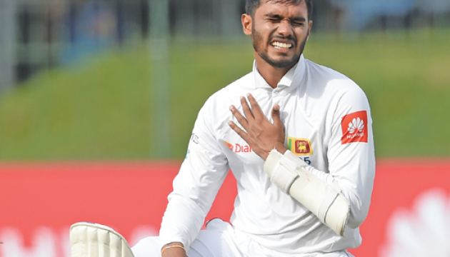 Sri Lankan cricketer Dhananjaya De Silva reacts after being hit by a ball delivered by South Africa's Kagiso Rabada during the first day of the second Test match between Sri Lanka and South Africa at the Sinhalese Sports Club (SSC) international cricket stadium in Colombo on July 20, 2018.  AFP