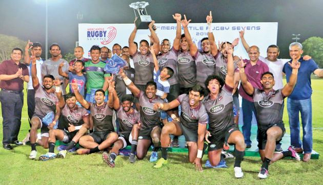 Access celebrate their win in the Mercantile Rugby Sevens Cup championships. pic by Saman Sri Wedage