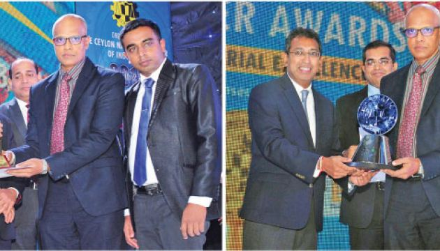 Teejay Lanka's Deputy General Manager – Internal Audit, Hemantha Mannaperuma and Manager Operations – HR & Admin, Tharindu Dissanayaka receive the Top 10 Achiever award from Prime Minister Ranil Wickremesinghe and the Silver Award in the Extra Large Category of the Manufacturing Sector from State Minister of National Policies and Economic Affairs Dr. Harsha de Silva.