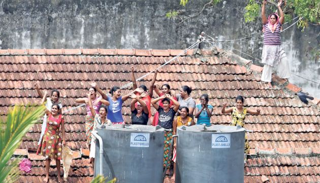A group of female inmates staged a rooftop protest at the Welikada Prison in Colombo yesterday, over the delay in expediting their court cases. Picture by Rukmal Gamage