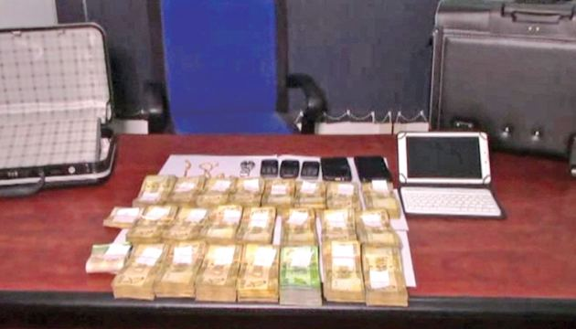 The stock of money, jewellery and electronic equipment seized by police. Picture by Anuradha Priyadarshana, Karandeniya Group Corr.