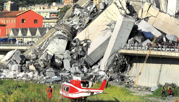 Rescuers work at the site where the Morandi motorway bridge collapsed in Genoa yesterday. - AFP