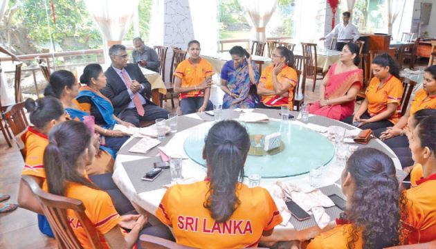 Sports Minister Faiszer Mustapha with the Sri Lanka netball team during the felicitation ceremony held at NOC premises yesterday.