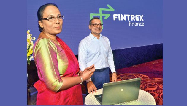 'Fintrex Finance Limited' Chairman, Ajit Gunwardene and CEO, Tamara Dharmakirti after unveiling Herath 'Fintrex Finance Limited' new logo. Picture by Wimal Karunatillke