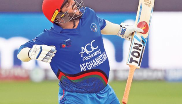 Afghanistan's stocky opener Mohammad Shahzad who resembles a modern day Duleep Mendis celebrates after scoring a century against India – AFP