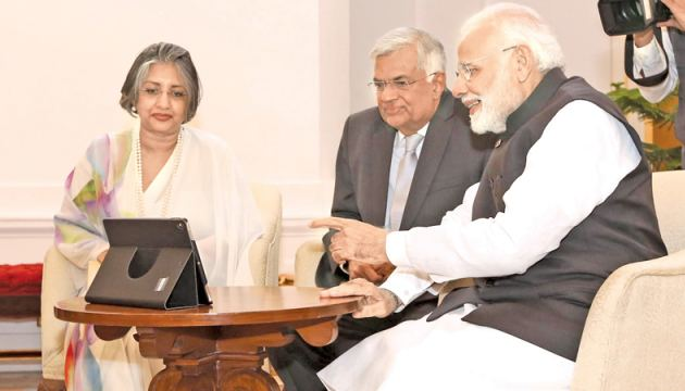 Indian Prime Minister Narendra Modi, Prime Minister Ranil Wickremesinghe and Prof. Mrs. Maithree Wickremesinghe listen to a new version of an ancient Gujarati Bhajan song performed by Sri Lankan artistes, at Hyderabad House on October 20. Picture courtesy Prime Minister's Media Division