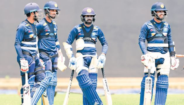 Sri Lankan captain Dinesh Chandima (2L), Kusal Mendis (R), Sadeera Samarawickrama (L) and Niroshan Dickwella (2R) during a practice session at the R. Premadasa Stadium ahead of today's fifth and final ODI against England. - AFP