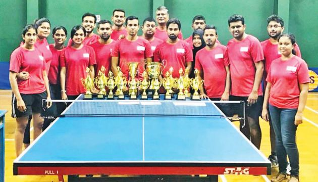 'A' and 'B' division champions MAS TT teams with their trophies