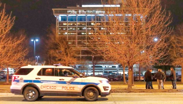 Law enforcement personnel investigates the area outside of the Chicago Mercy Hospital  where a gunman opened fire in Chicago on Monday.  - AFP