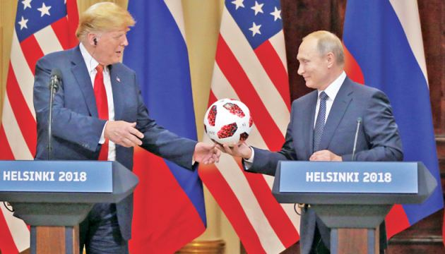 Russian President Vladimir Putin presented US President Donald Trump a soccer ball from the 2018 FIFA World Cup, Helsinki, Finland in this July 16, 2018 file photo.