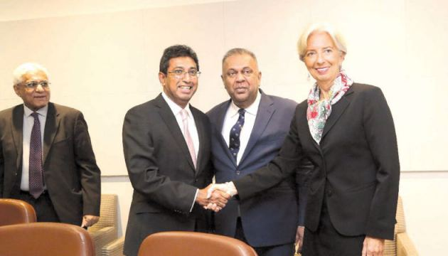 Finance and Mass Media Minister Mangala Samaraweera, Minister of Economic Reforms and Public Distribution Dr Harsha De Silva and Governor Indrajit Coomaraswamy with IMF Managing Director Christine Lagarde in Washington on Tuesday.