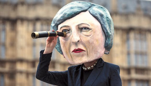 A demonstration  featuring a  papier-mache  Theresa May head outside the Houses of Parliament in  London on  January 15.