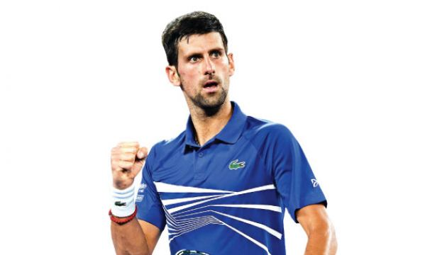 Serbia's Novak Djokovic reacts after a point against Russia's Daniil Medvedev during their men's singles match on day eight of the Australian Open tennis tournament in Melbourne early on January 22. AFP