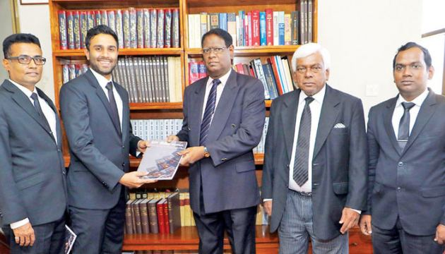 Neethiya Foundation Patron Upali A. Gooneratne PC presenting the Neethiya - 28th Anniversary Volume to Chief Justice Nalin Perera in his Chambers at the Supreme Court yesterday. Members of the editorial board look on. Picture by Sulochana Gamage